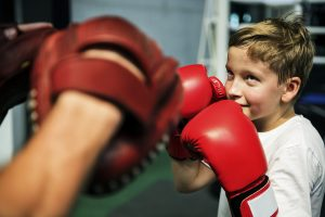 young boy doing boxing exercises