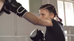 Young girl doing non contact boxing exercises