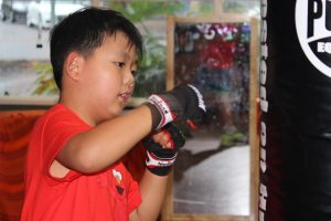 Young boy doing boxing practice